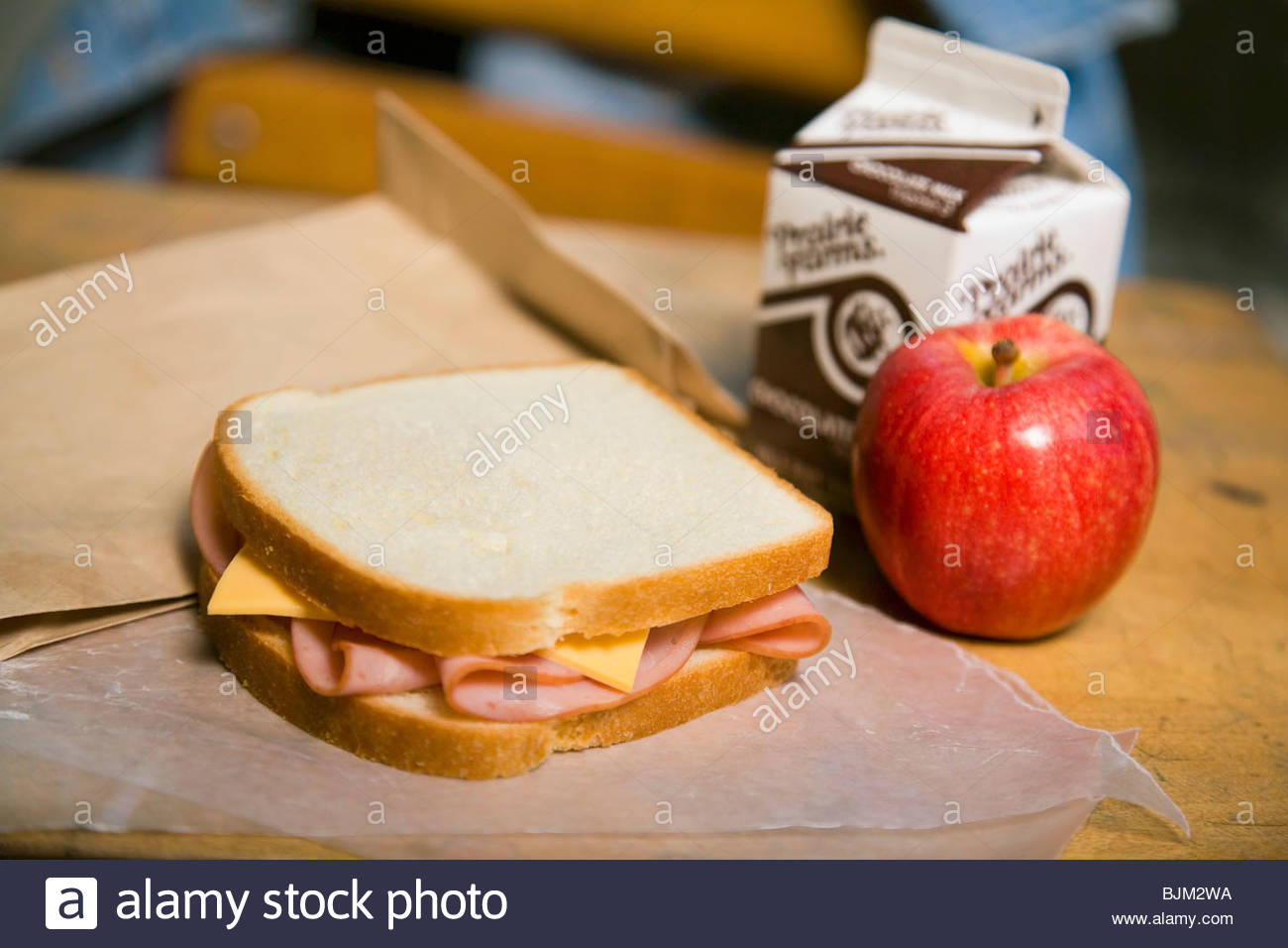 School Lunch Ham And Cheese Sandwich Apple And Chocolate