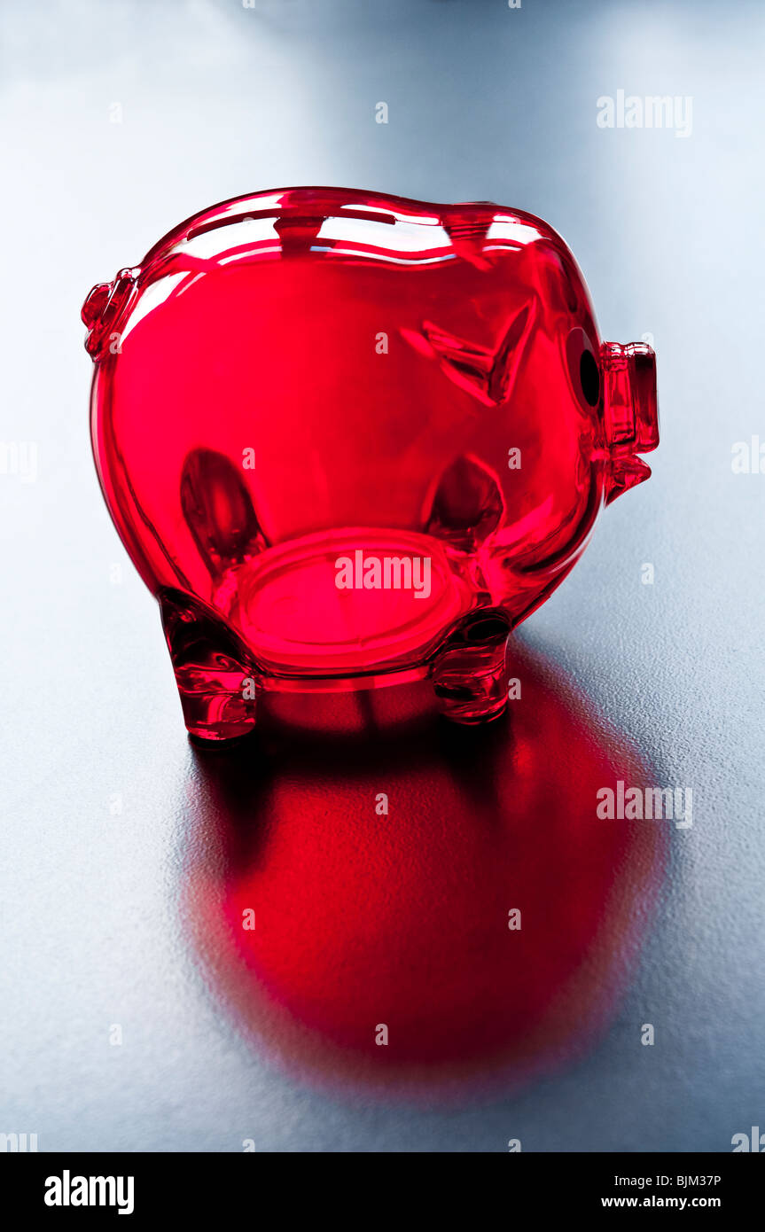 Piggy Bank empty, with no savings, in the red, in debt. Stock Photo