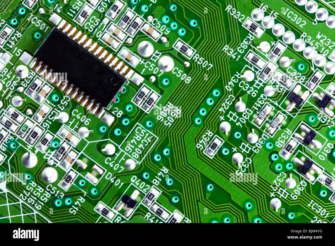 Macro shot of an electrical circuit board and computer chip - Stock Image