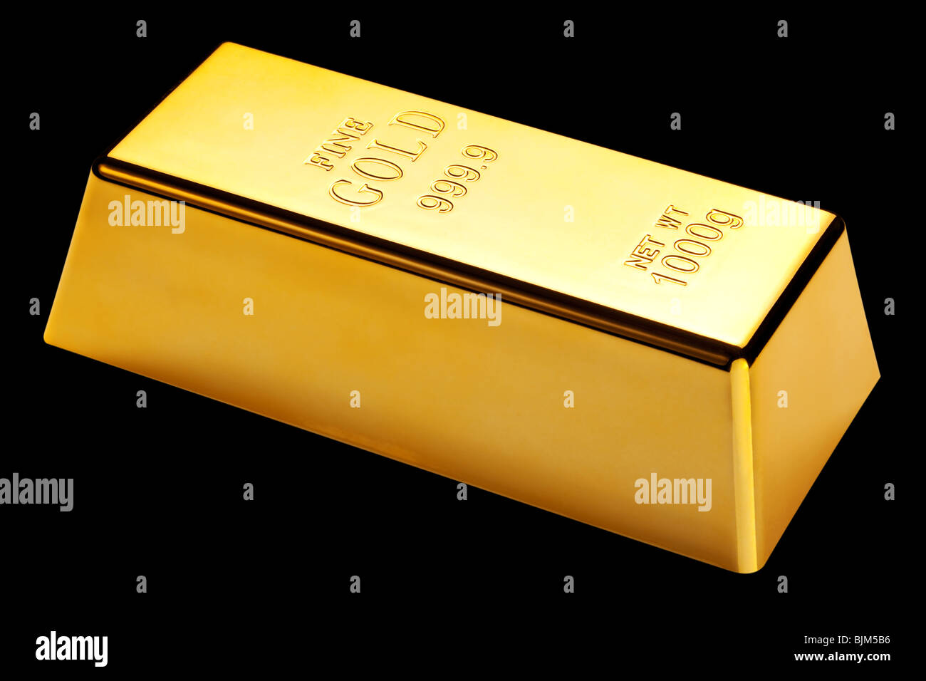 Photo of a 1kg gold bar isolated on a black background - Stock Image