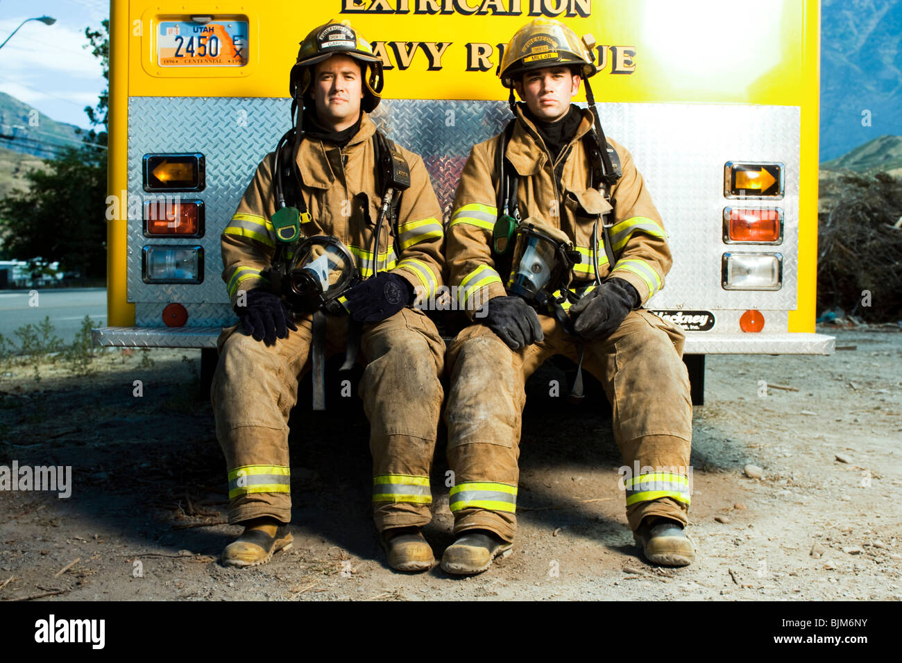 Portrait of two firefighters - Stock Image