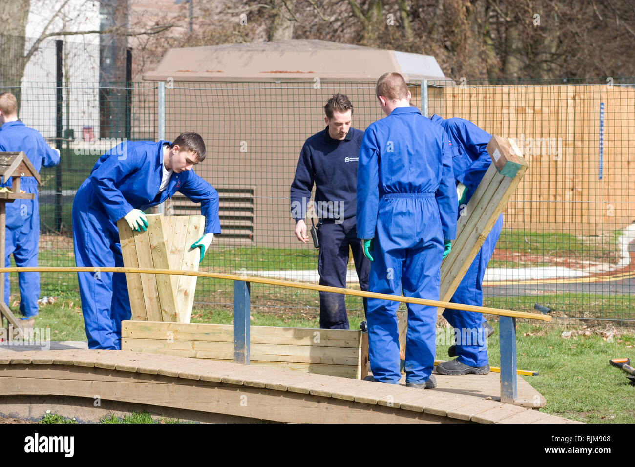 Students on a hard landscaping course - Stock Image