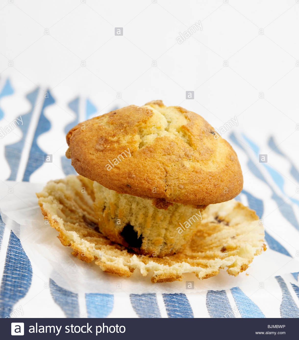 Blueberry Muffin with Liner Peeled Off - Stock Image