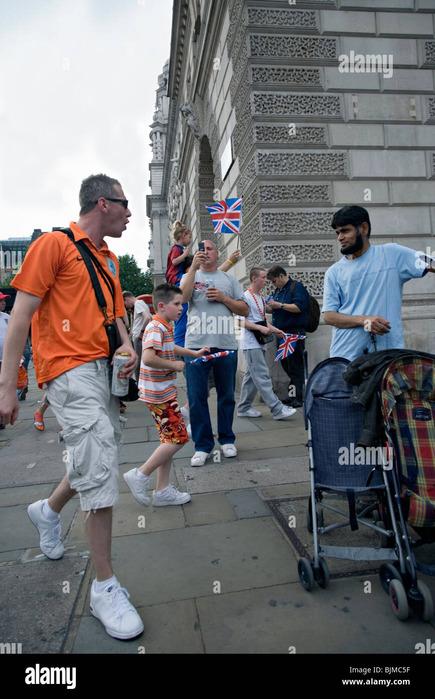 a mam from an orange walk in london confronts an asian man - Stock Image