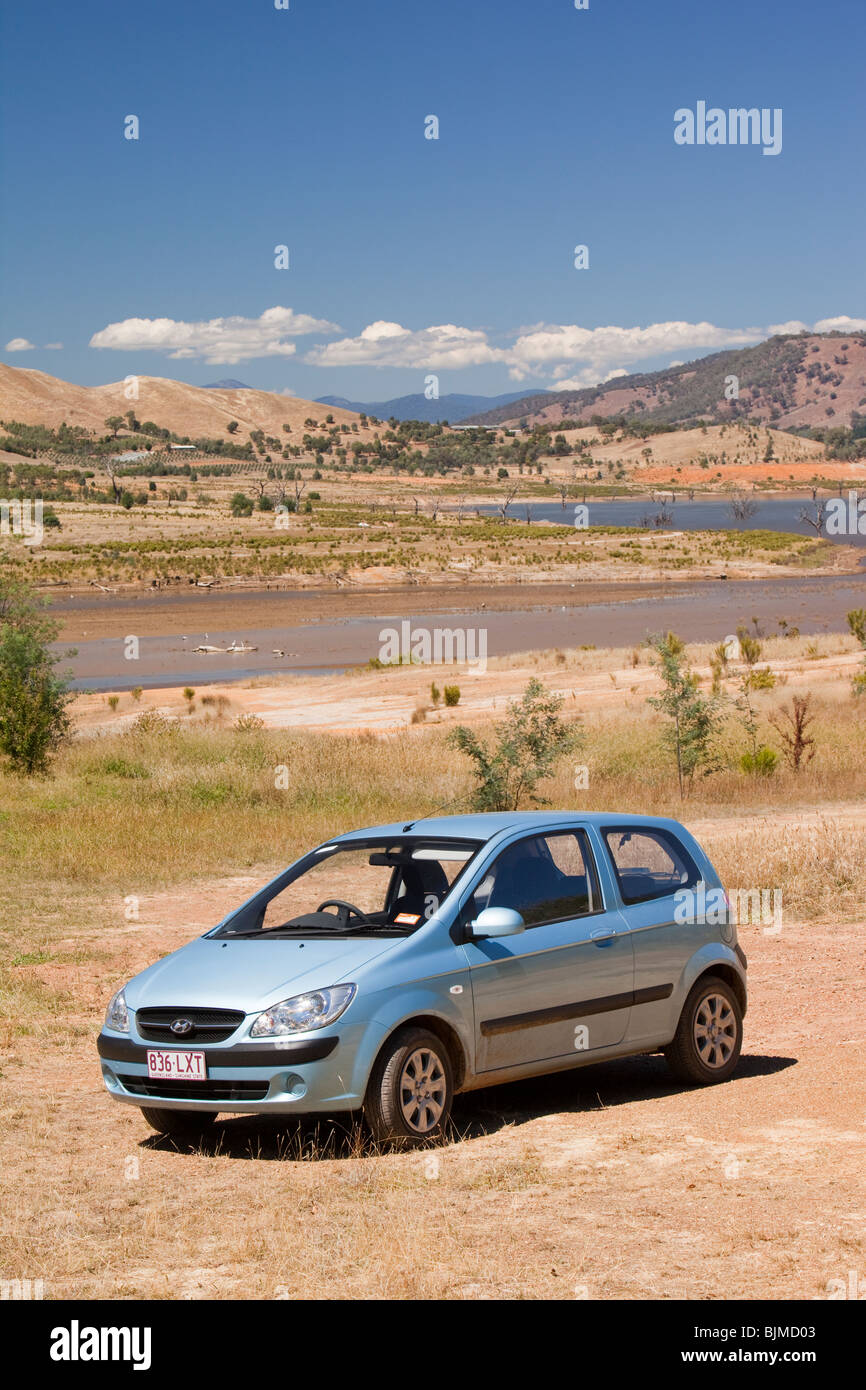 A car parked where water used to reach on Lake Eildon due to the ongoing drought, Australia. - Stock Image