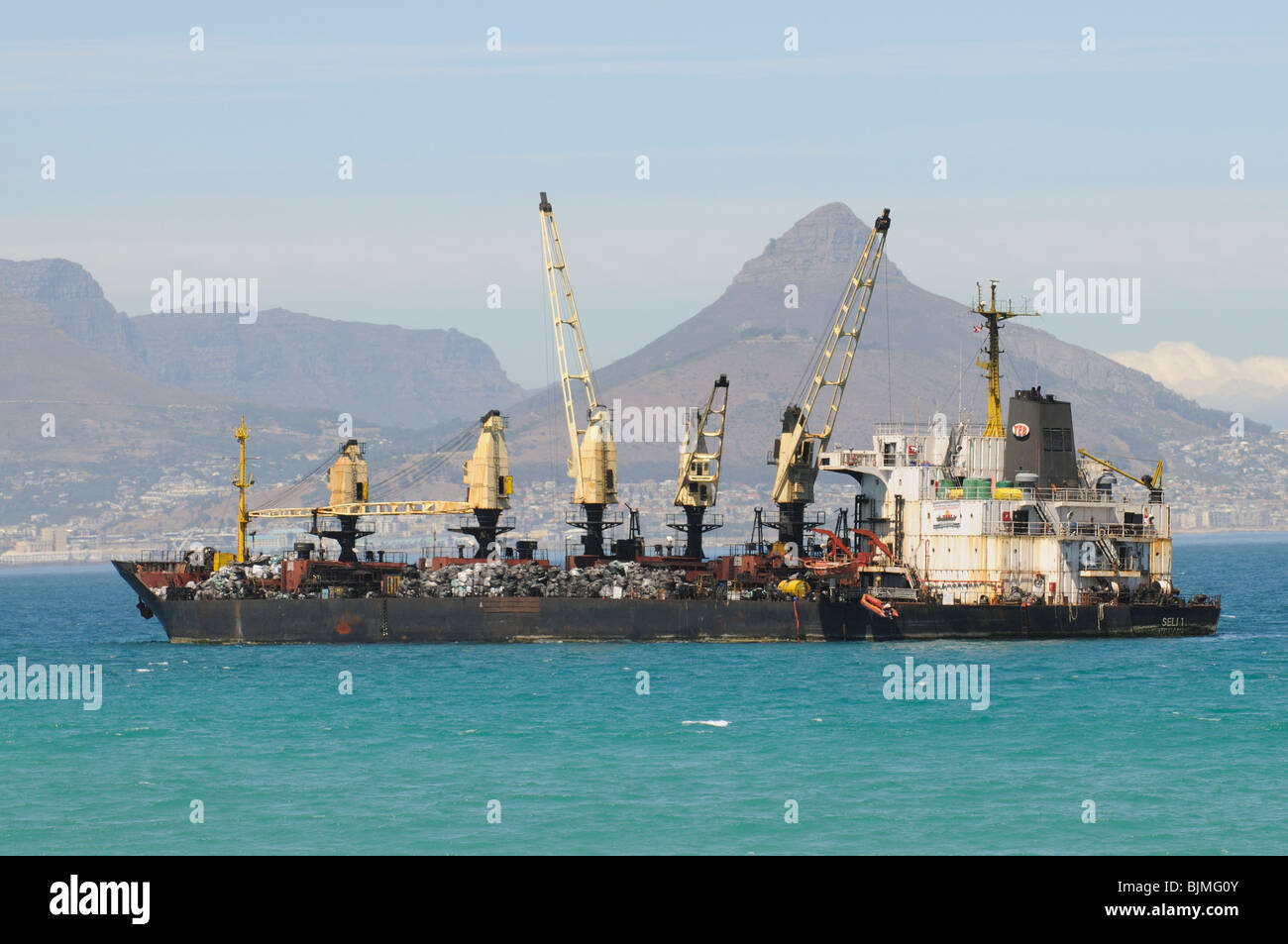 The Seli 1 a small bulk carrier lays aground in Table Bay off Cape Town South Africa. Close to the beach at Bloubergstrand - Stock Image