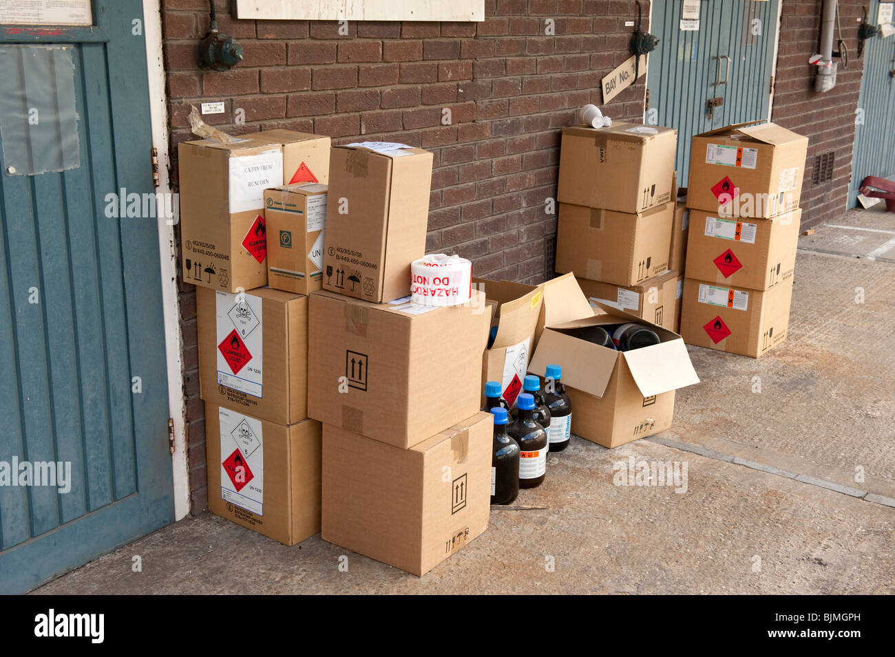 Boxes of flammable toxic chemicals stacked against wall