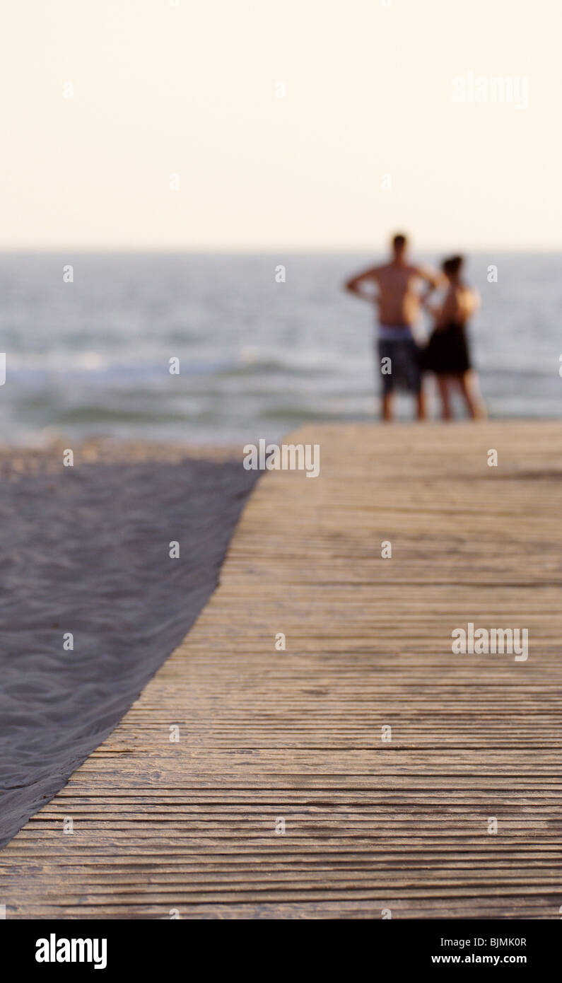 Couple on a jetty - Stock Image