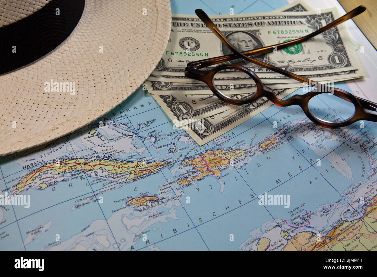 Planning a trip to the Caribbean, Cuba, historical reading glasses, U.S. Dollar - Stock Image