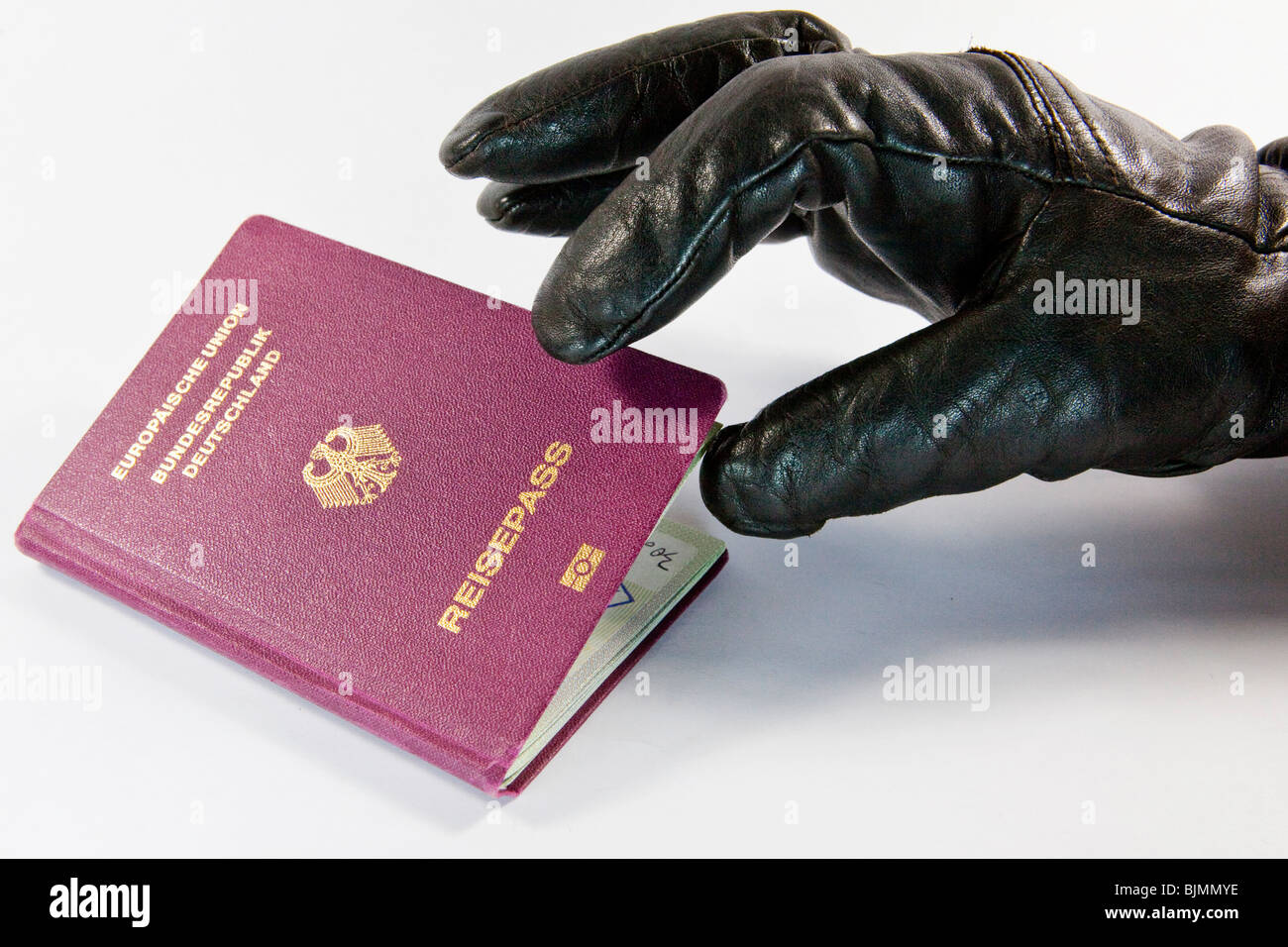 Gloved thief trying to steal a passport - Stock Image