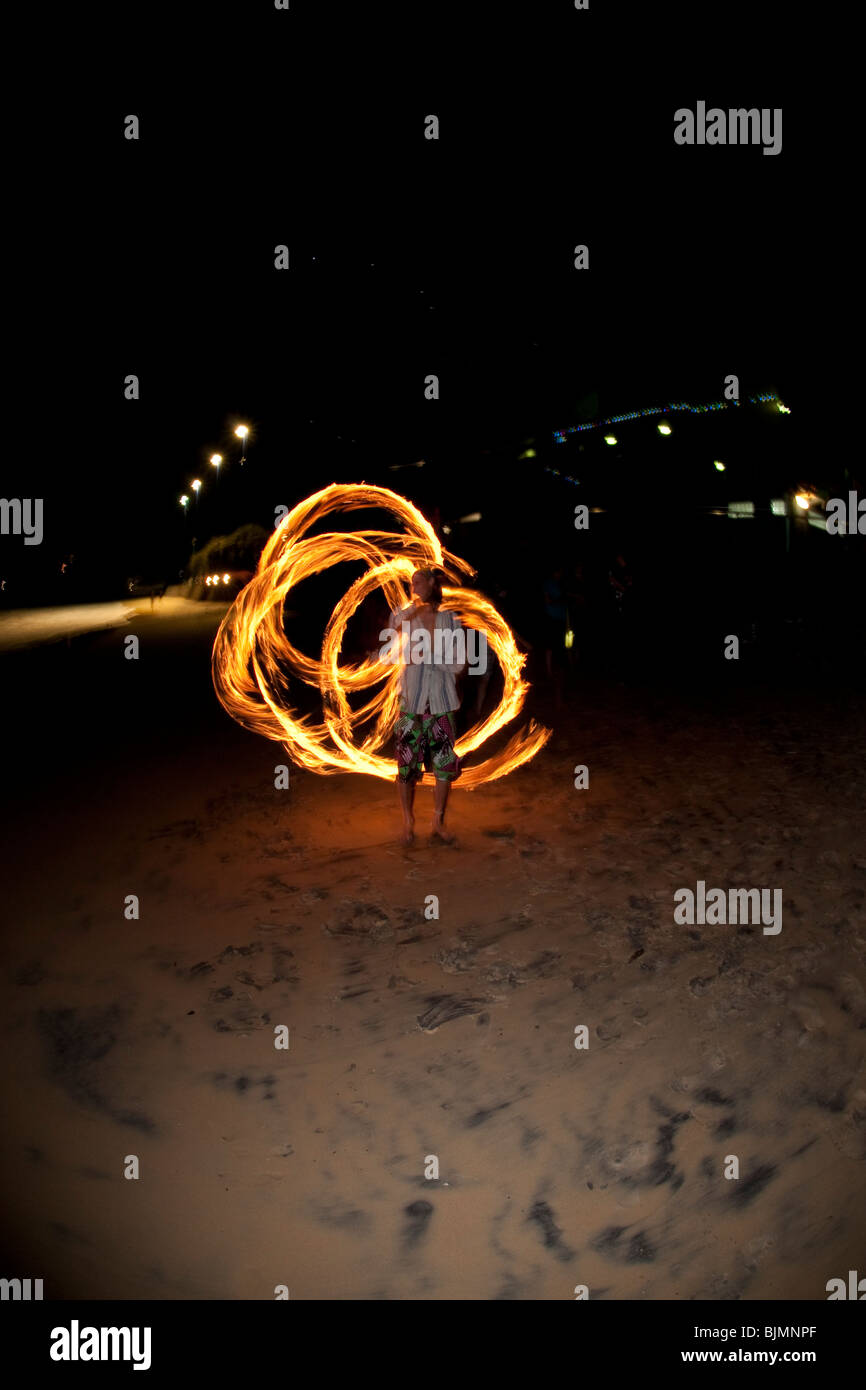 FIRE TWIRLING ON MOOLOOLABA BEACH Stock Photo
