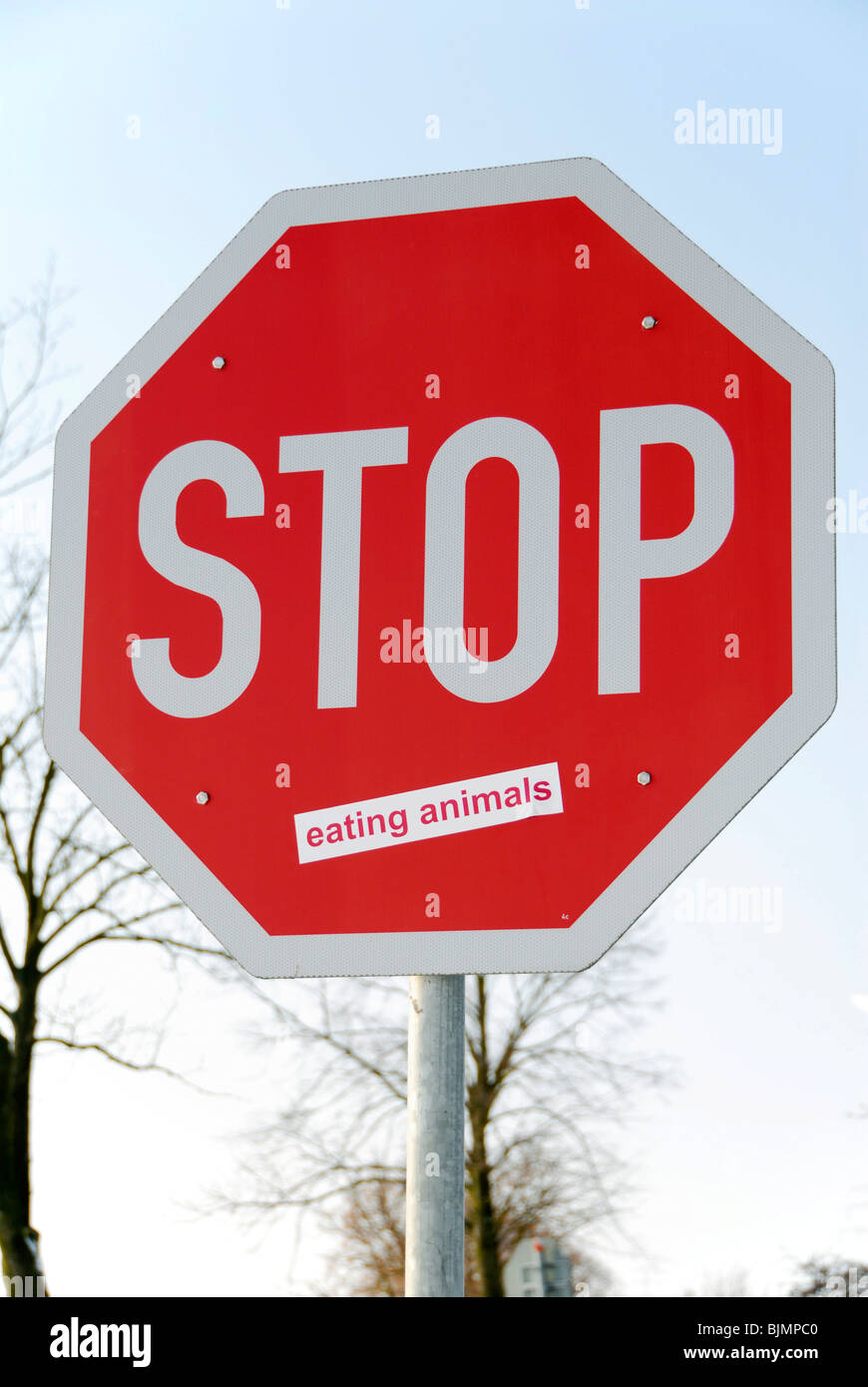 Stop eating animals, stop sign with sticker - Stock Image