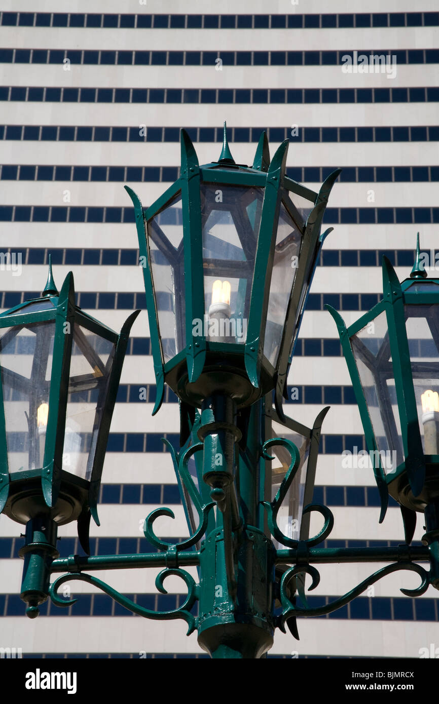 Old fashioned green lampost against a moder sky scraper, Downtown District Miami Florida USA - Stock Image