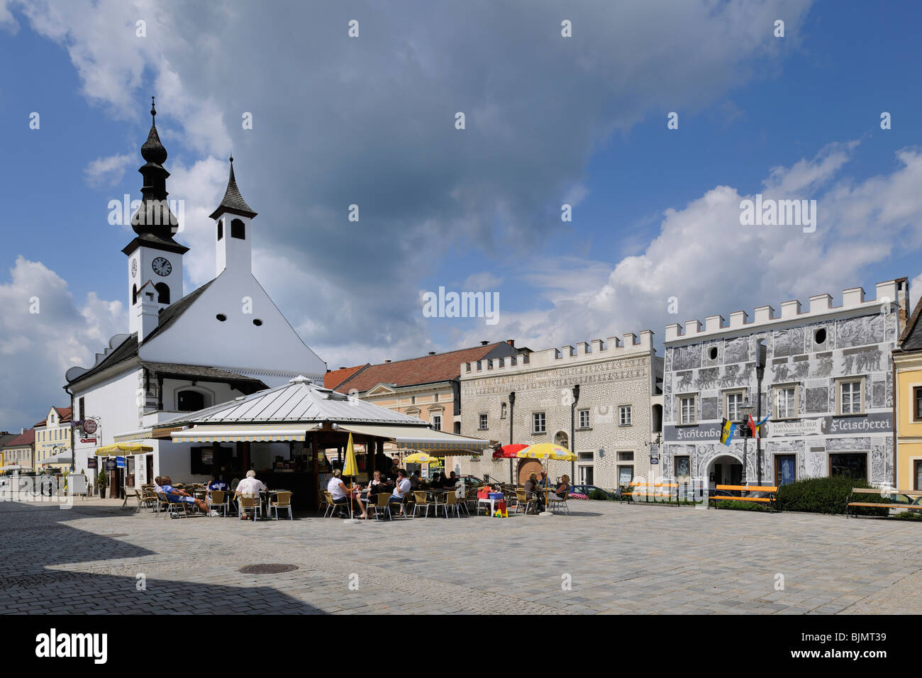 Houses with Sgraffito decorations, ice cafe and Schranne old town hall, main square of Gmuend, Waldviertel region, Stock Photo