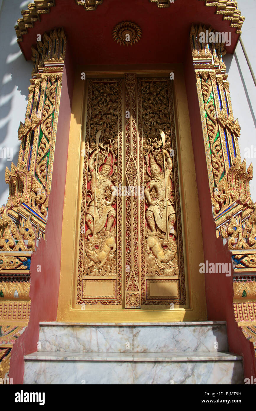 Buddhist door to a temple in Bangkok, Thailand. - Stock Image