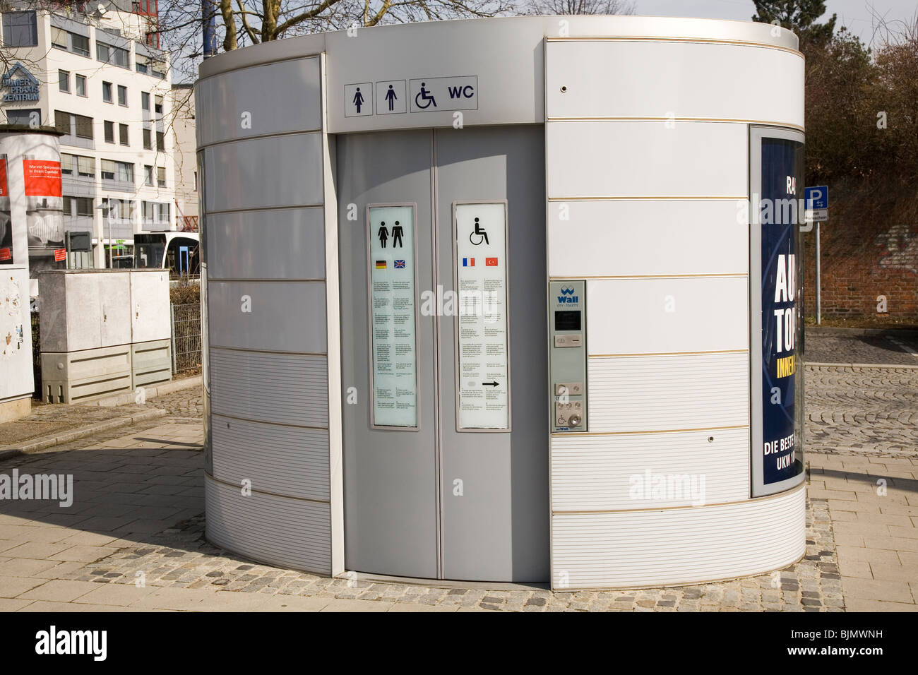 A modern pay-per-use public toilet (City Toilette) stands in the historic city of Ulm, Germany. - Stock Image