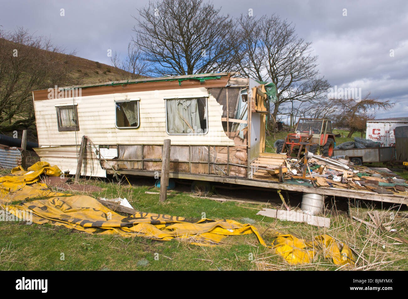 Derelict residential caravan on remote farmstead on mountainside above Pontypool Torfaen South Wales UK - Stock Image