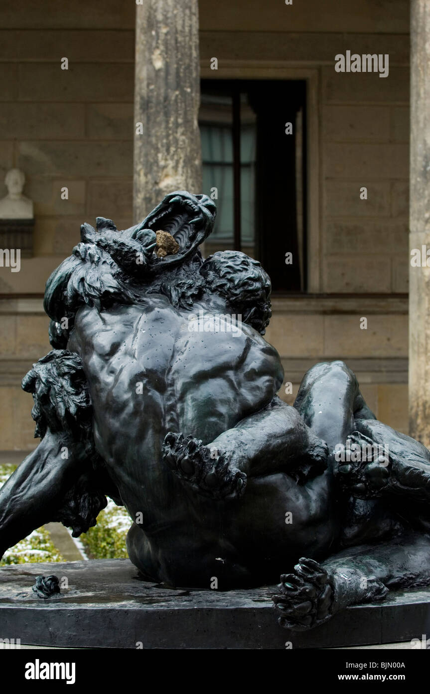 Berlin German statue of a man fighting a lion outside Neues museum Stock Photo