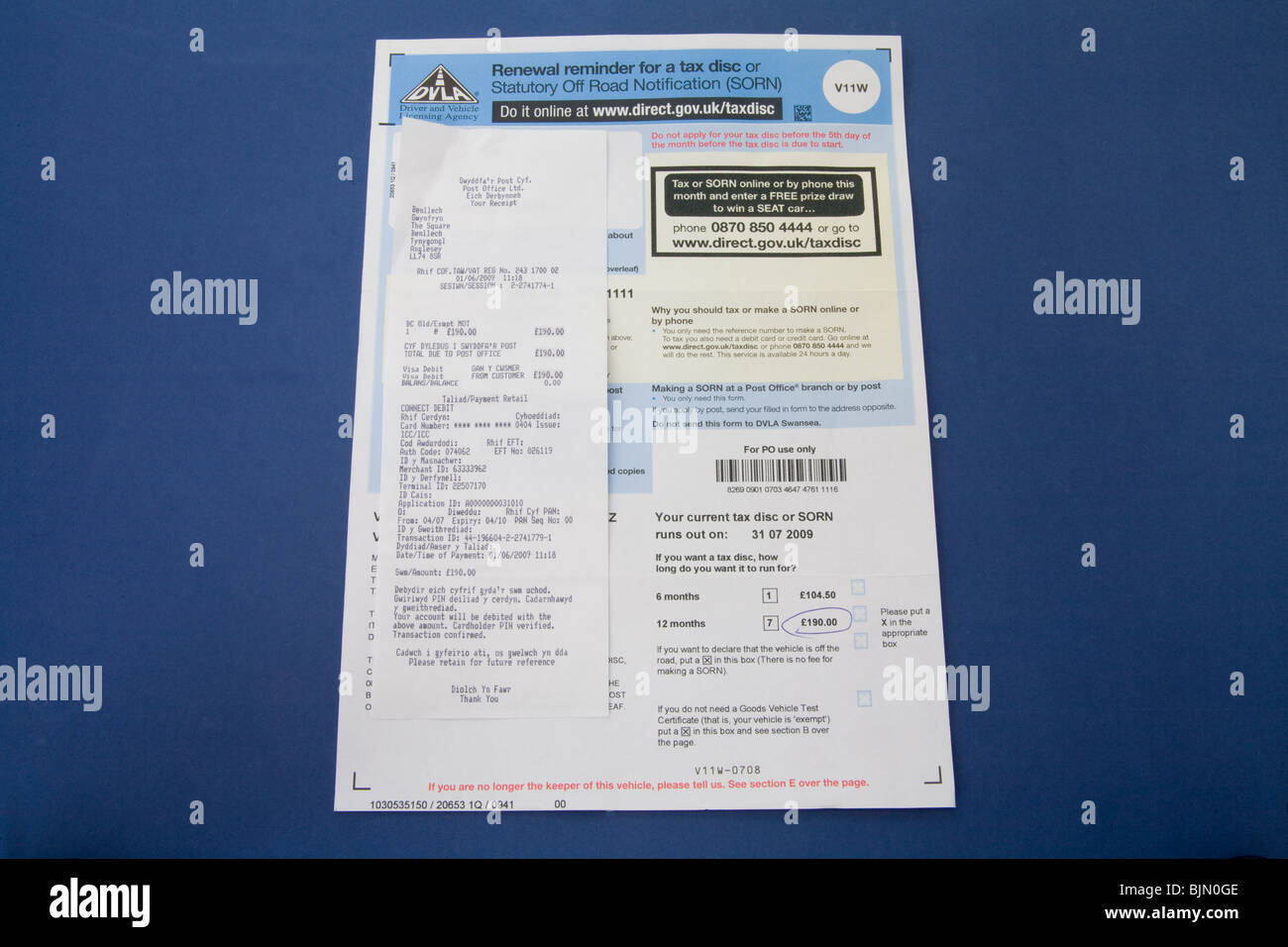 Close up Tax disc renewal notice from the DVLA and a receipt of payment from the Post Office - Stock Image