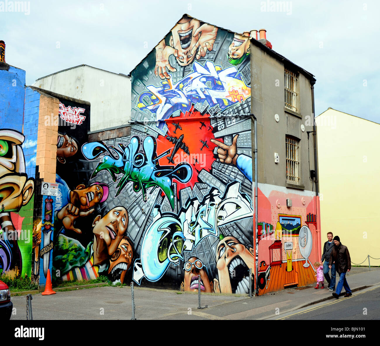 Buildings covered in approved graffiti art in the north laine area of brighton city centre uk