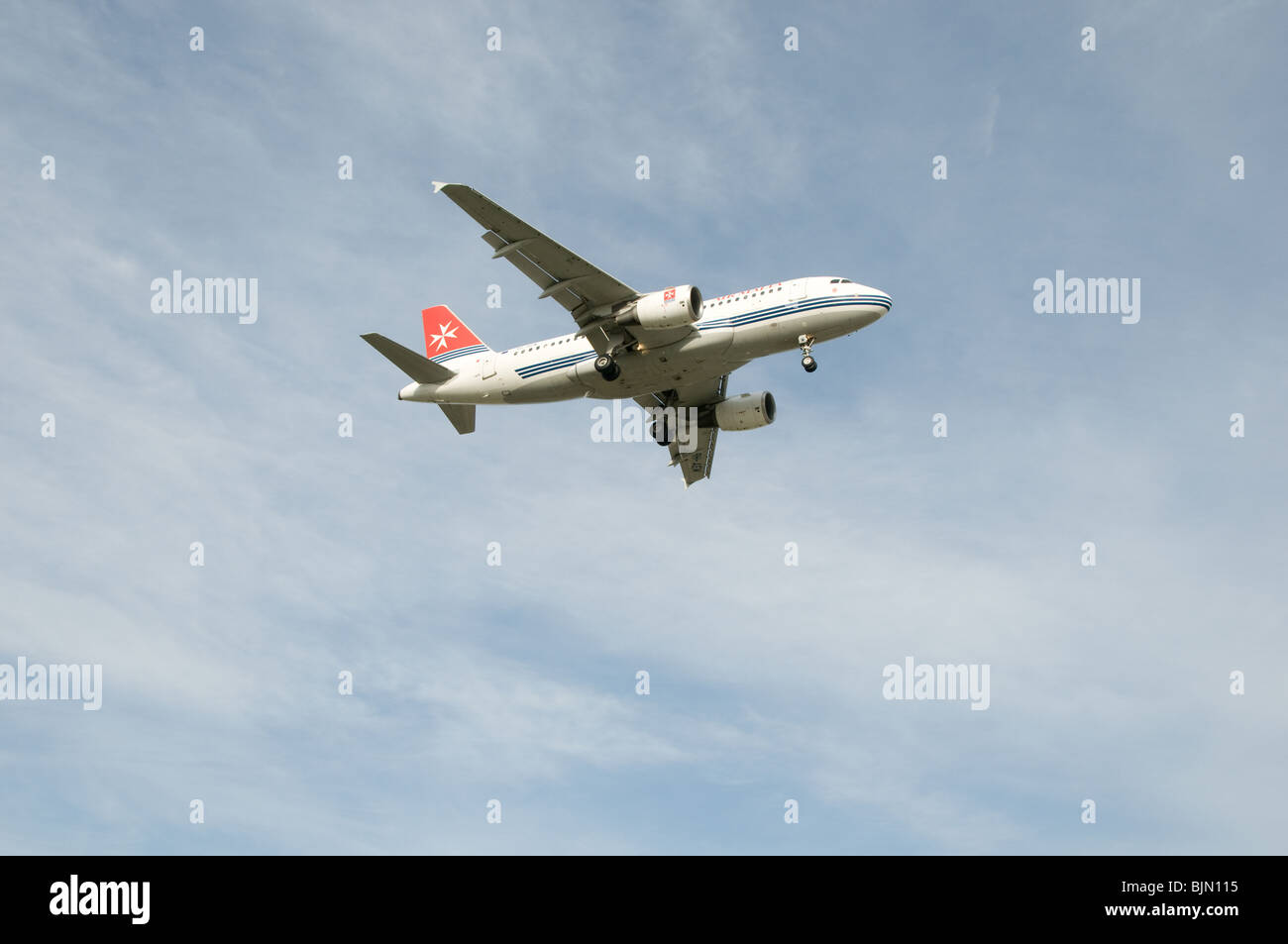 An Airbus A319-111 registration 9H-AEM comes into land at Malta International Airport, Luqa, Malta Stock Photo
