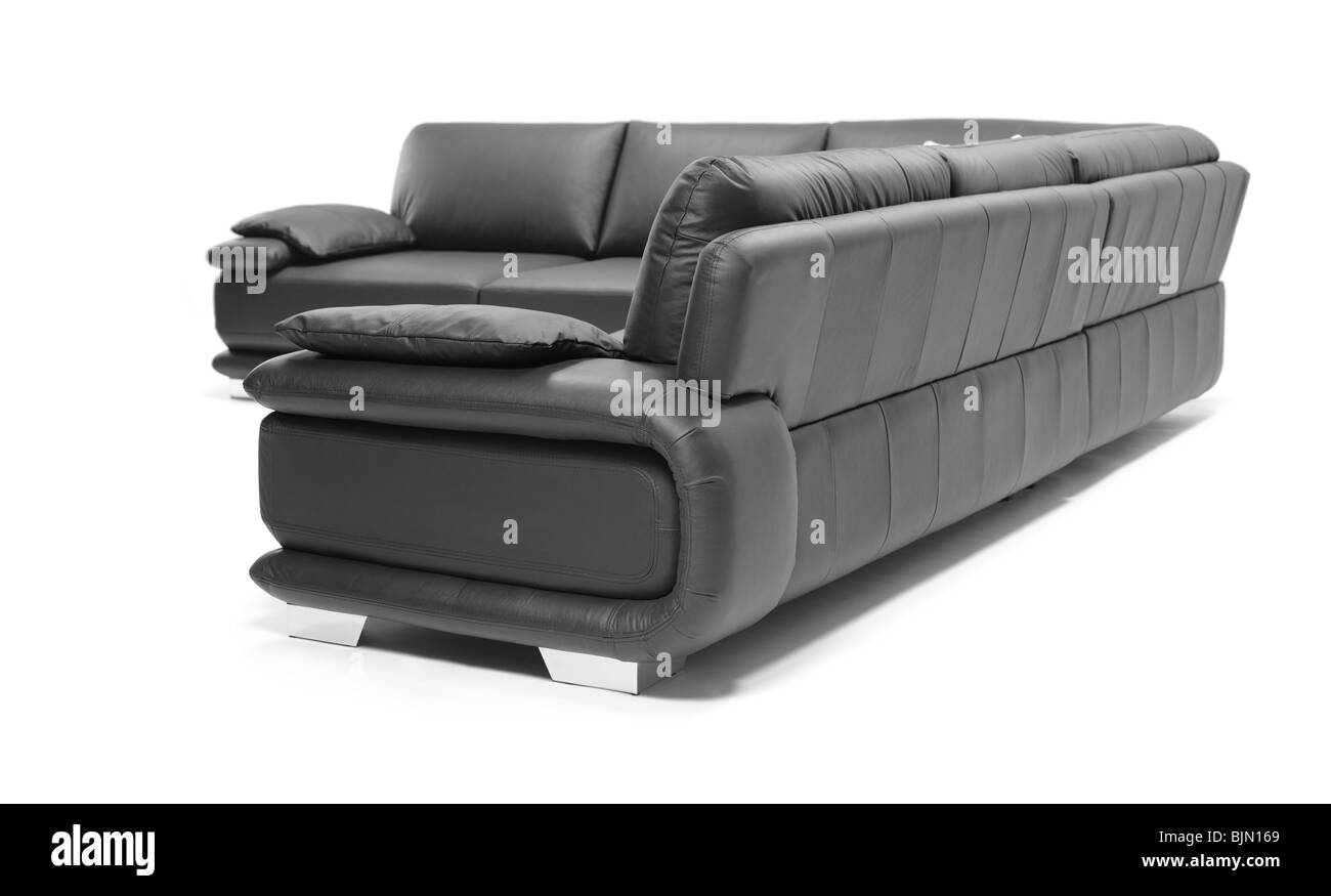 Image of a modern black leather sofa - Stock Image