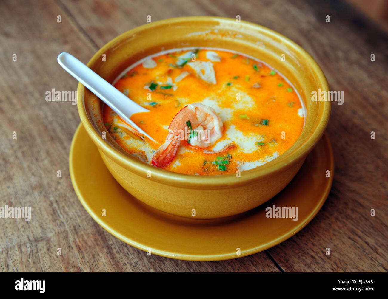 Bowl of spicy Thai Tom Yum Soup - Stock Image