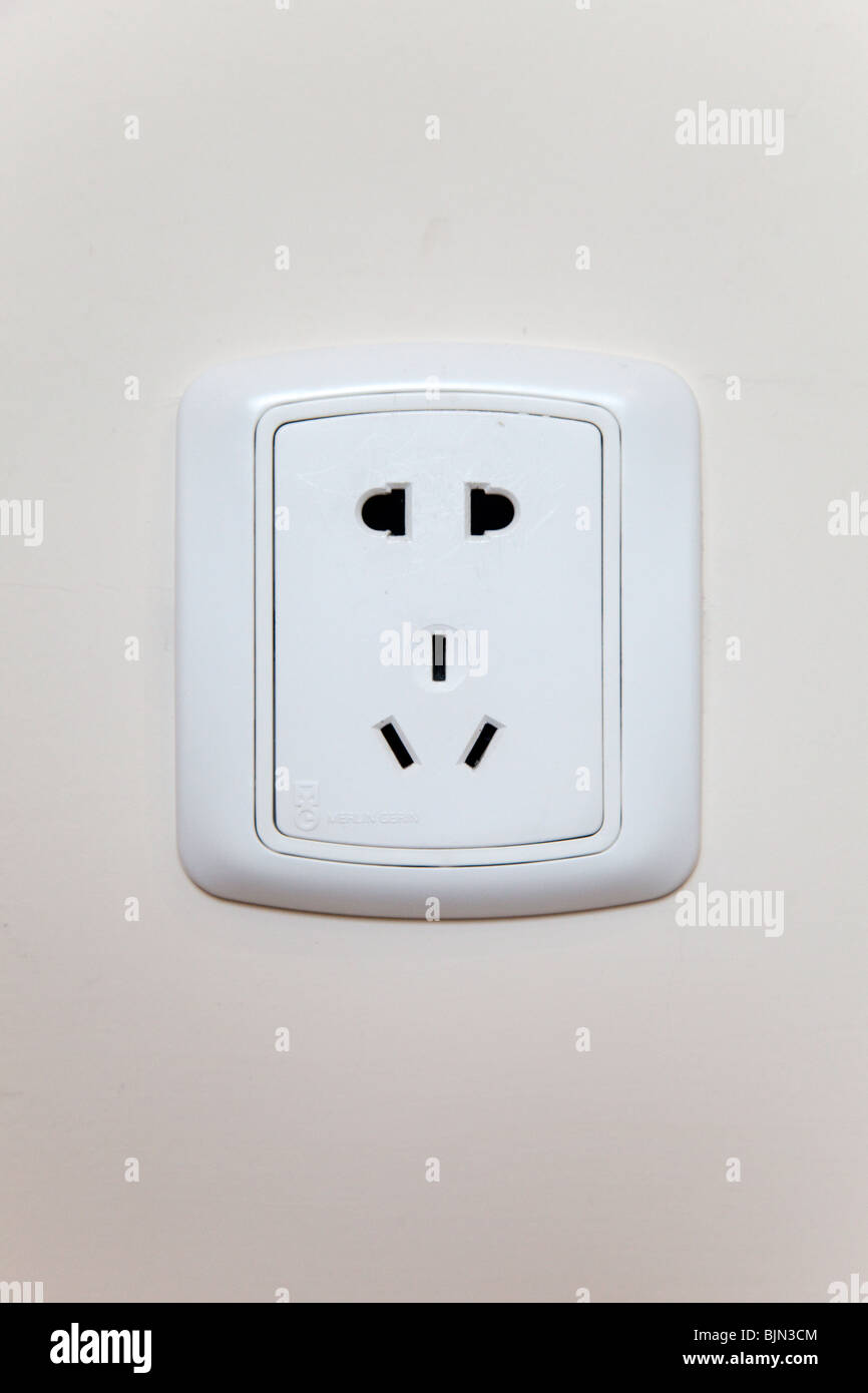 Electrical plug socket in wall of hotel, Shanghai, China Stock Photo ...