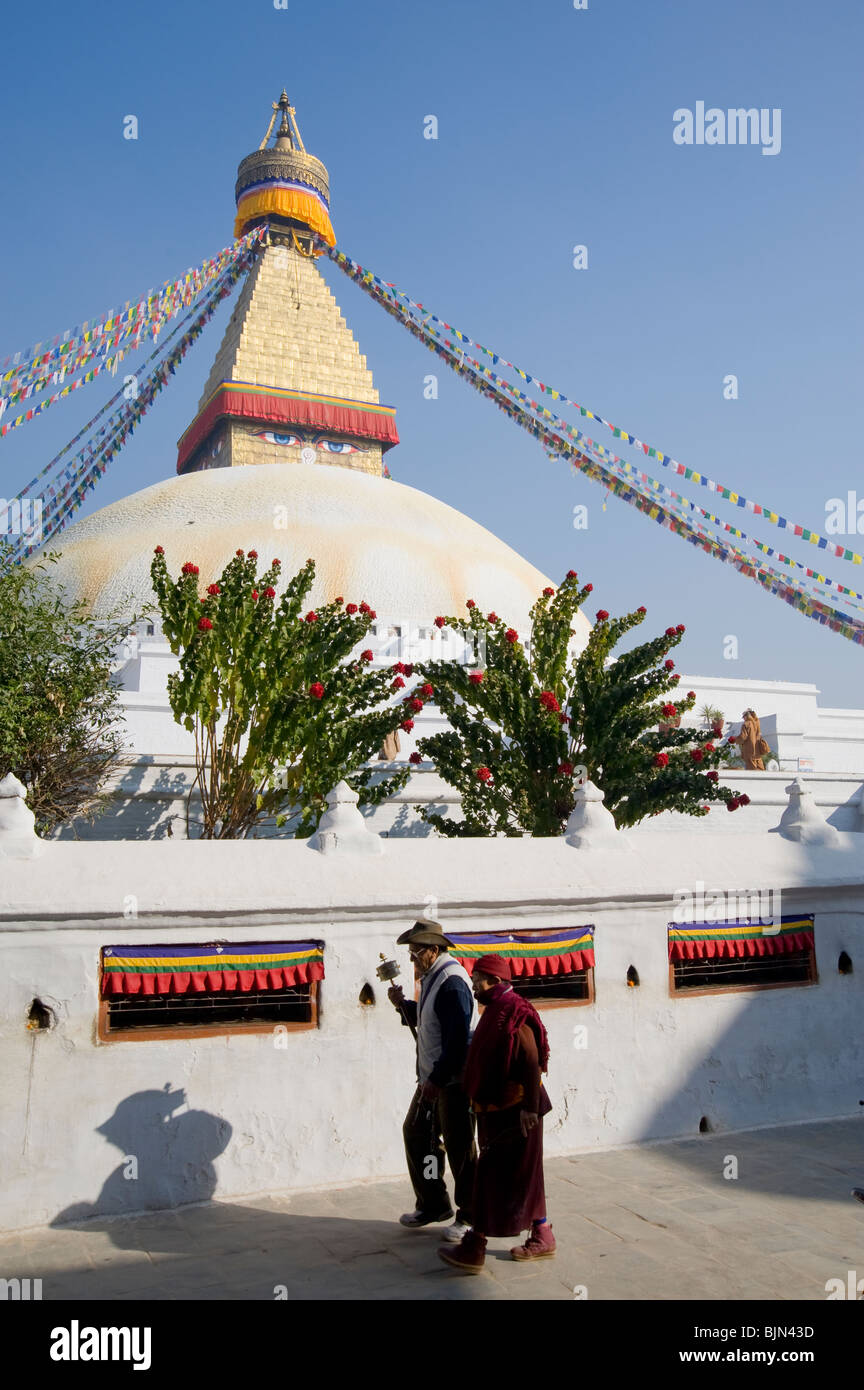 Buddhist pilgrims walking around the Boudhanath stupa in Kathmandu, Nepal - Stock Image