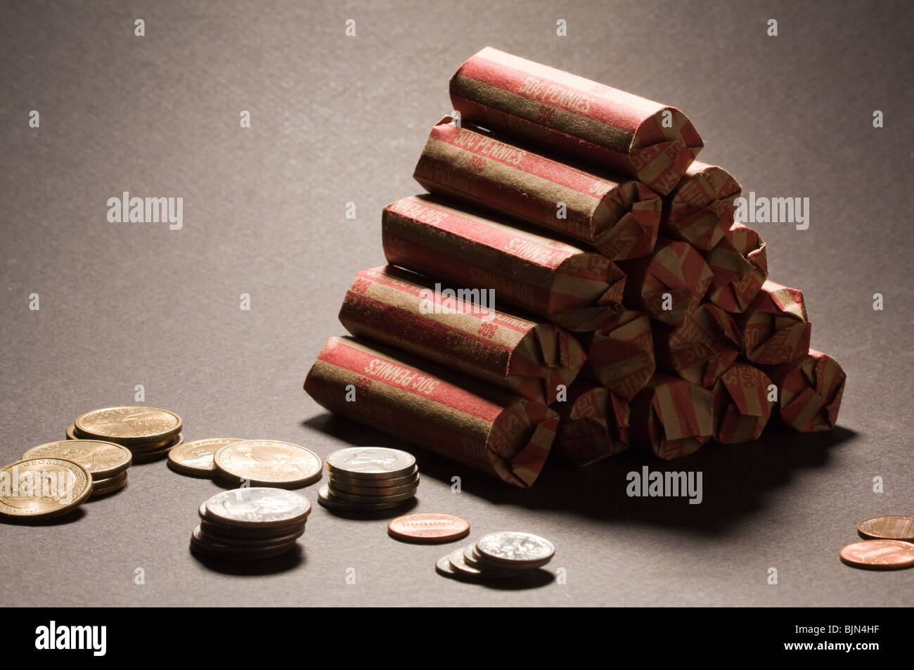 US Coins in 50¢ Pennies Wrapped on Black Background Stock Photo