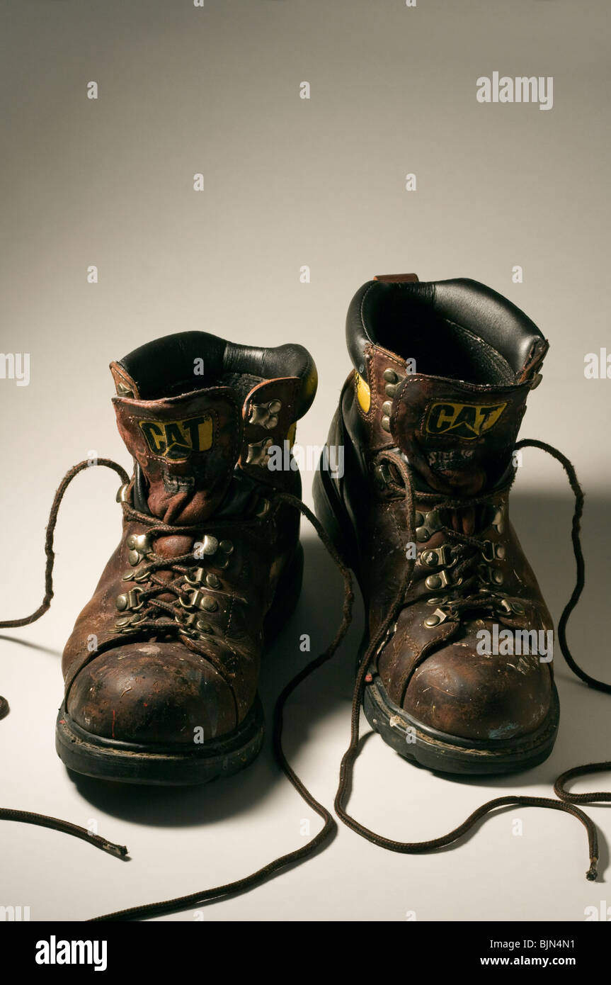 Caterpillar Steel Toed Work Boots on White Background. - Stock Image