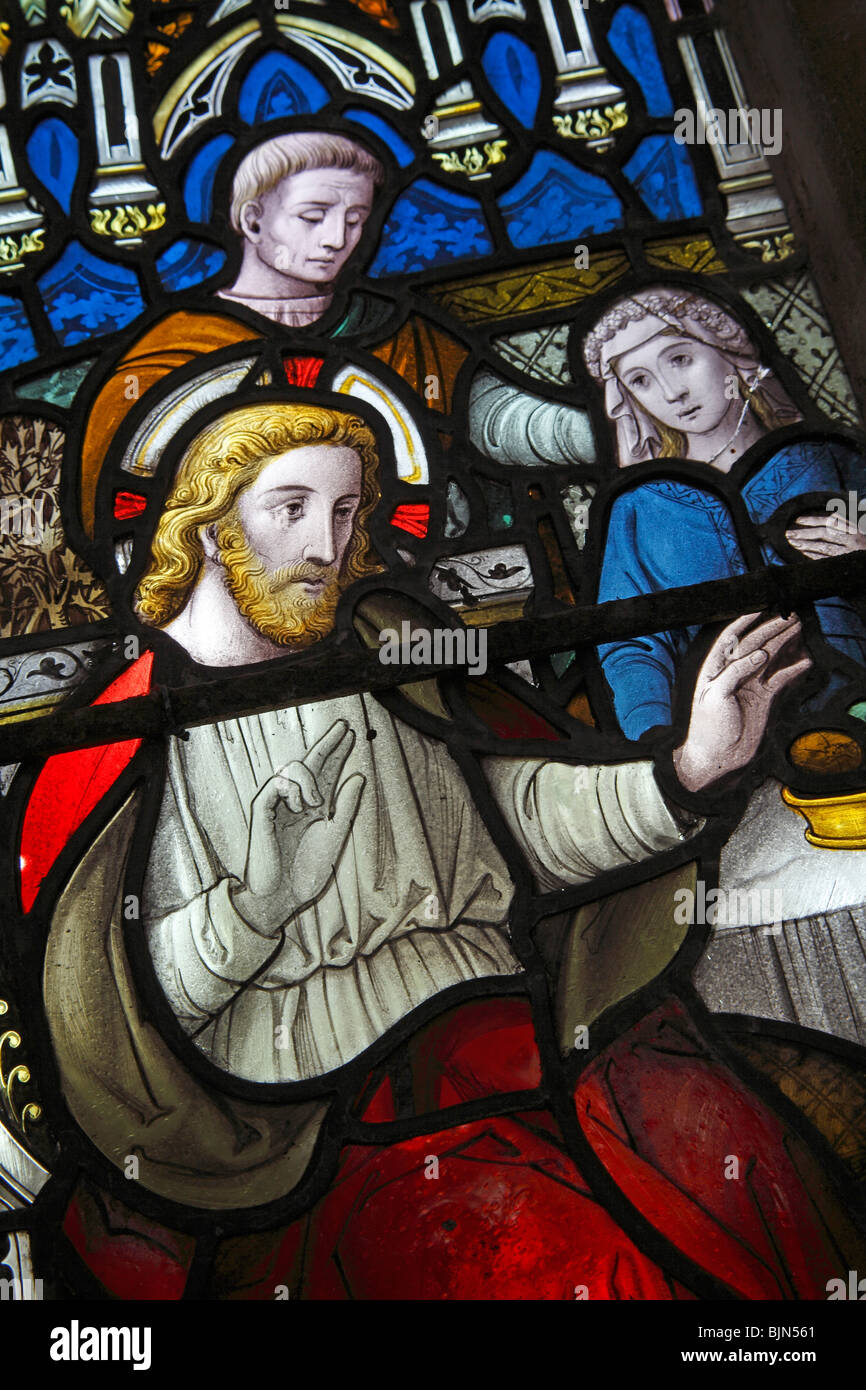 A stained glass window depicting Jesus performing miracles, St Margaret's Church, Witton, Norfolk - Stock Image