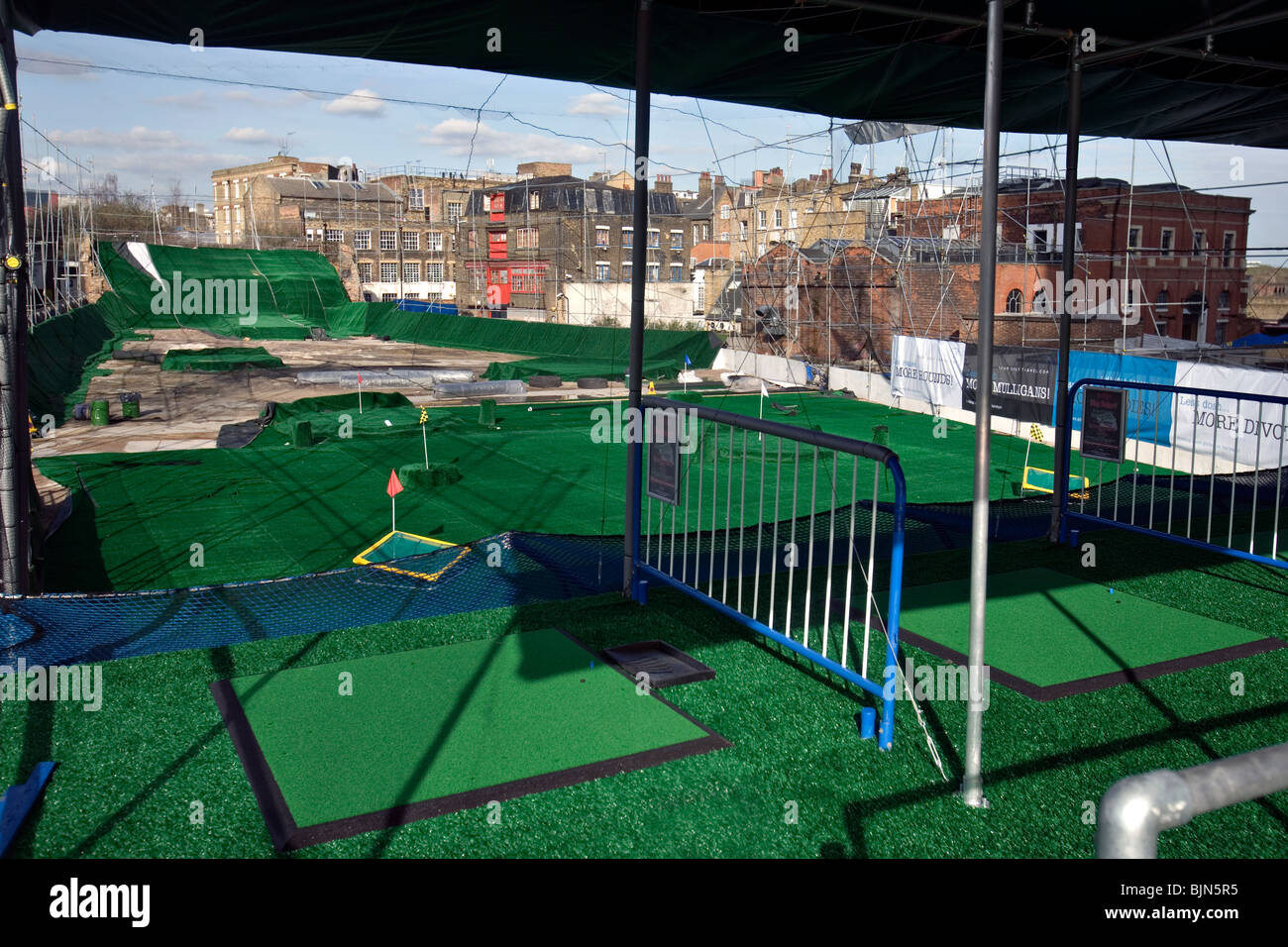 a new golf driving range in the city of london - Stock Image