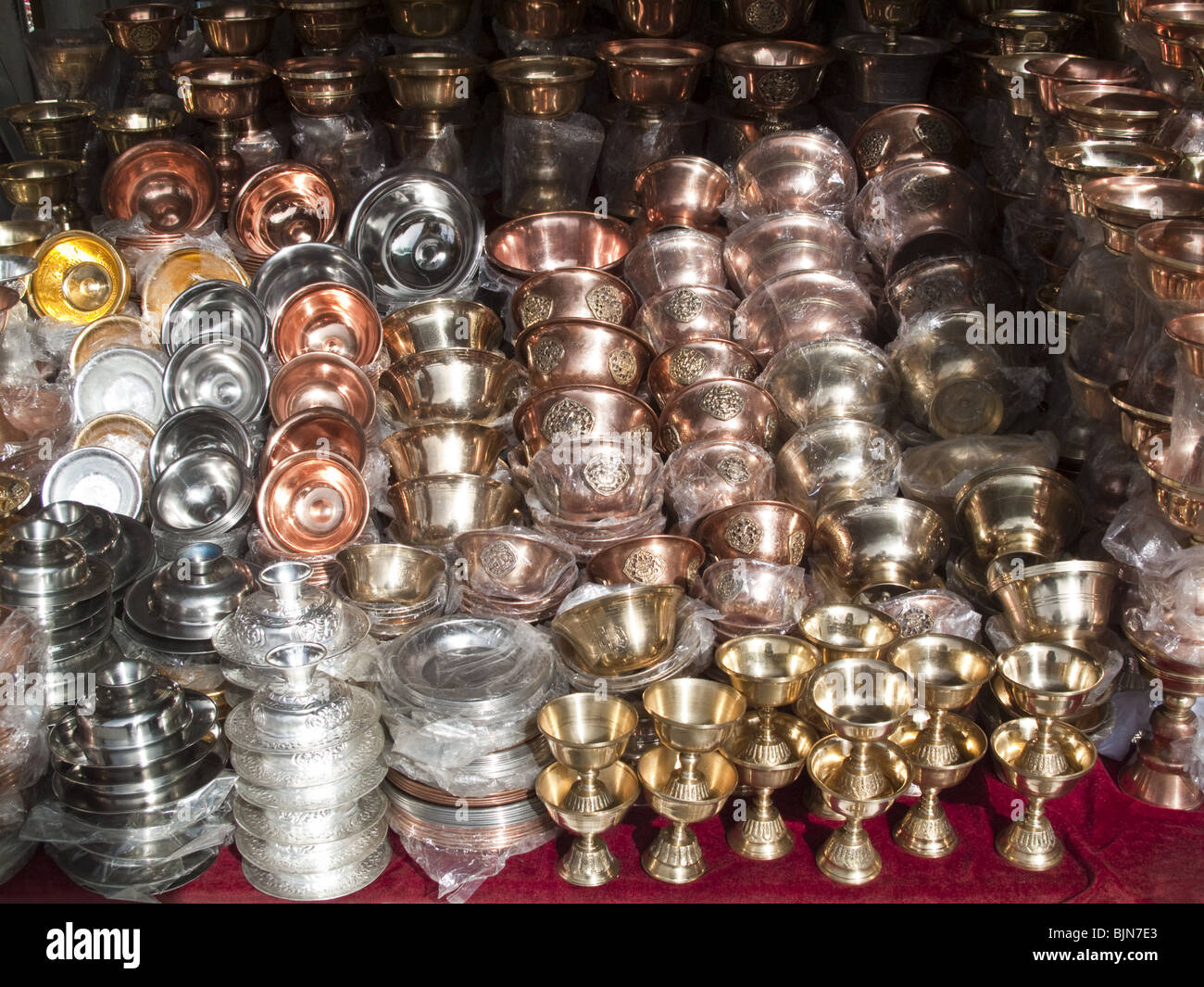 Stacks of candle holders in Barkhor Square Market, Lhasa, Tibet - Stock Image