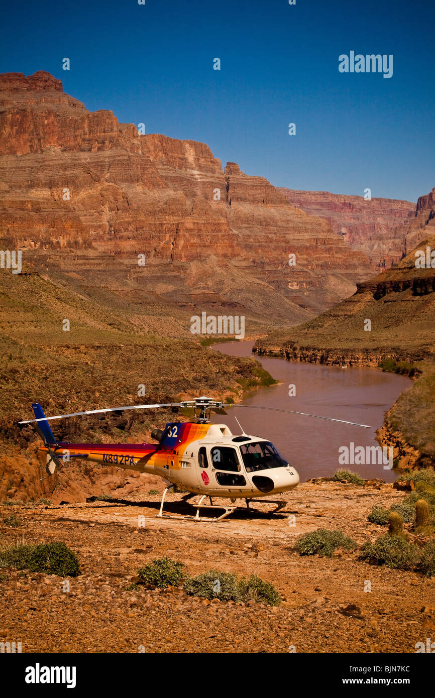 A helicopter at the Colorado river at the base of the Bridge Canyon along the west rim of the Grand Canyon National - Stock Image