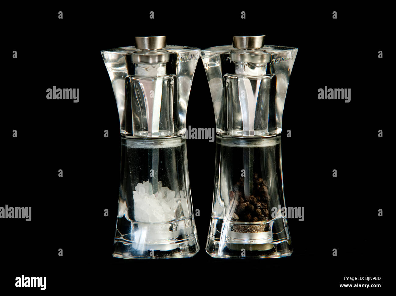 Salt and pepper mills isolated on black - Stock Image