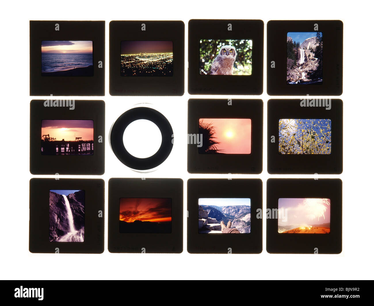 Colorful vintage slides on a light table. Note: All slides were taken by the photographer and are included in the - Stock Image