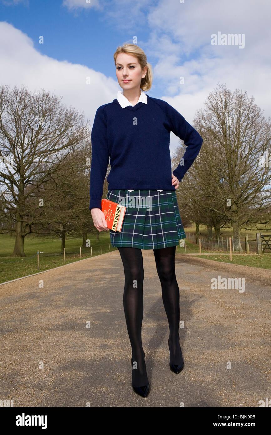A Blond Woman In A Schoolgirl Uniform Outside Wearing A