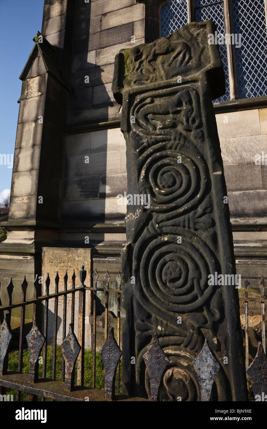 Saxon cross in the churchyard at All Saints Church, Bakewell, Derbyshire. Stock Photo