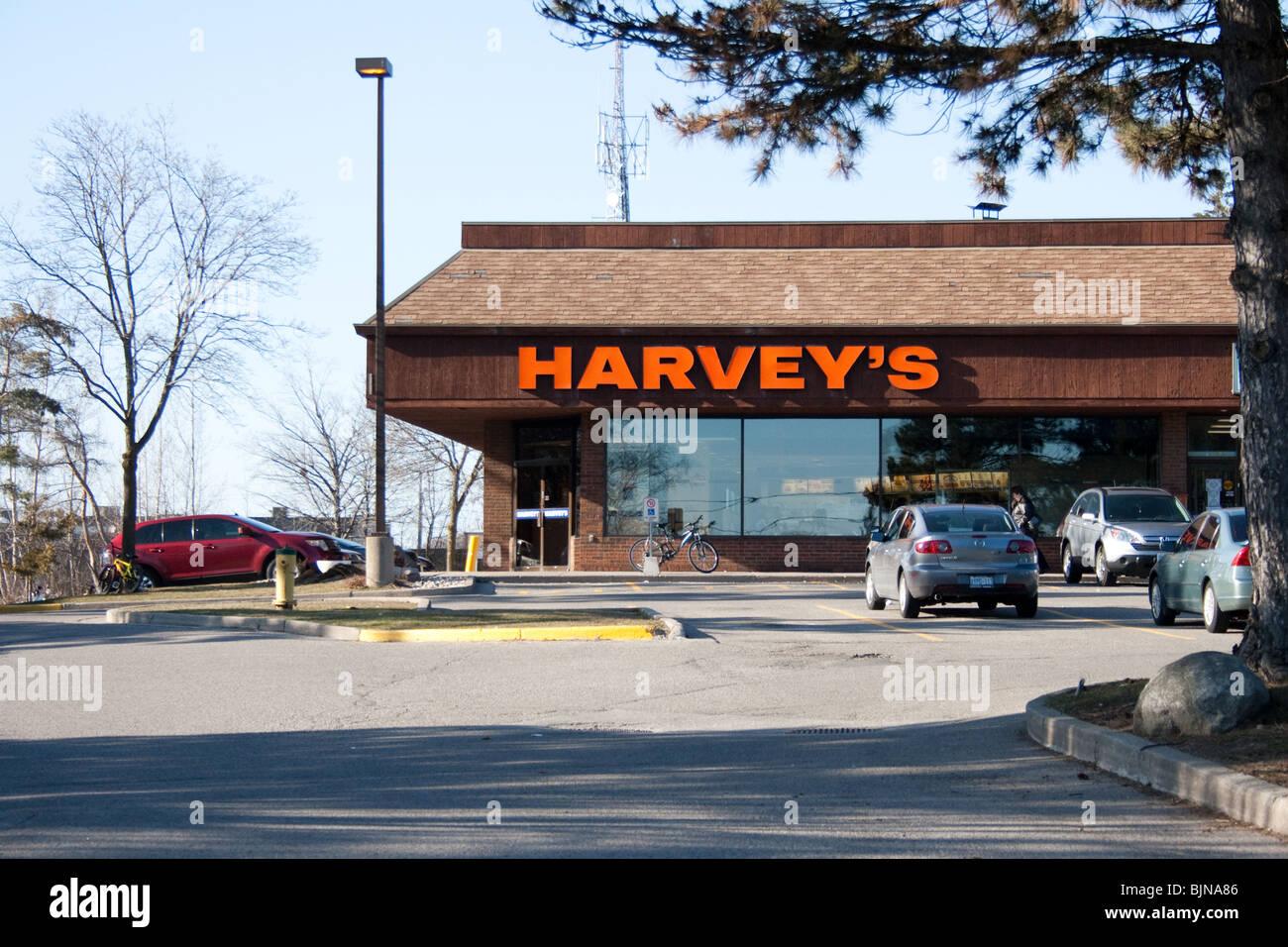 harvey harvey's harveys fast food burger restaurant unhealthy fries coke oily fat mcdonald burger king cheap - Stock Image