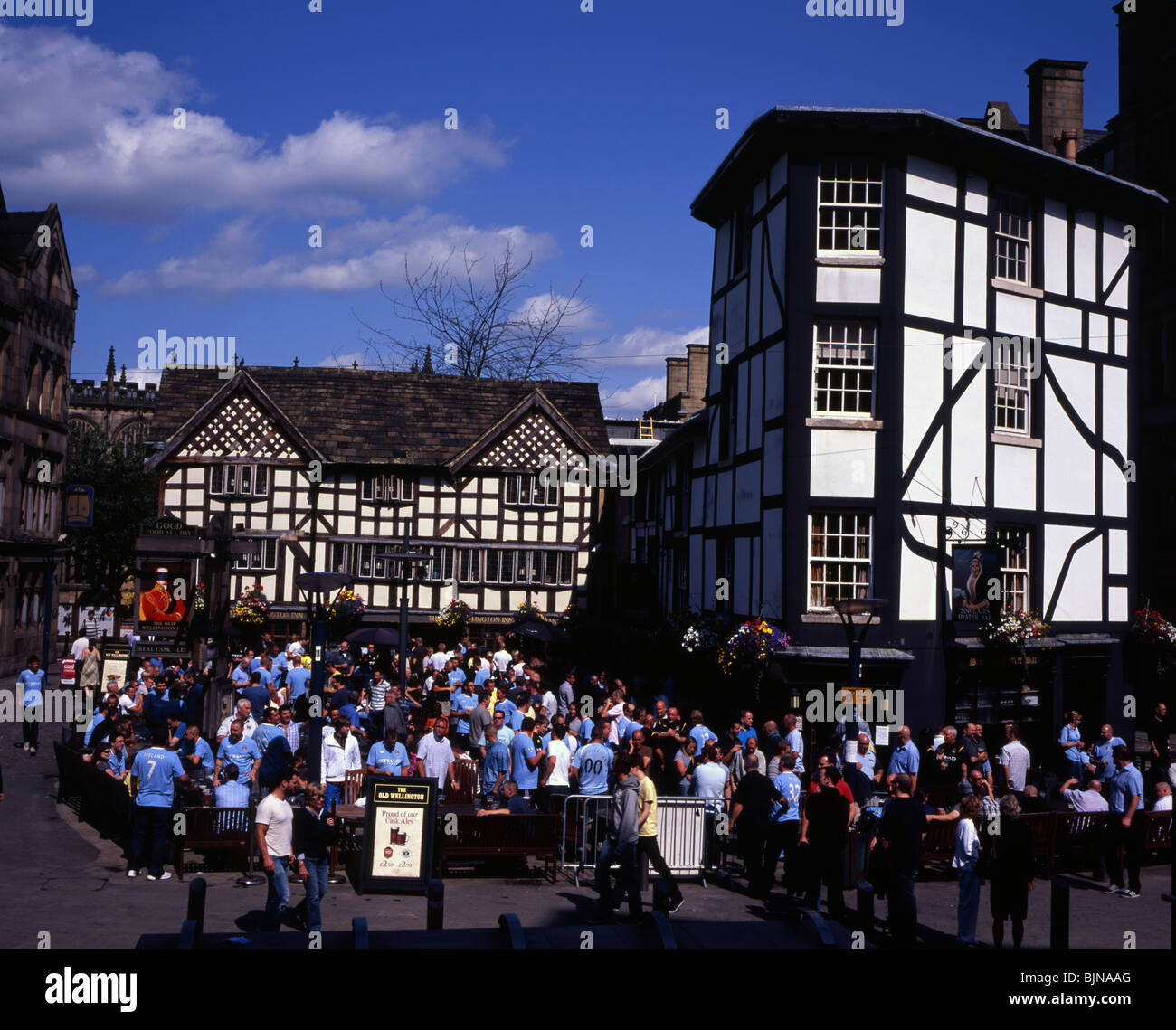 Sinclairs Oyster Bar and The Duke of Wellington Pub match day with Manchester City Supporters Manchester England - Stock Image