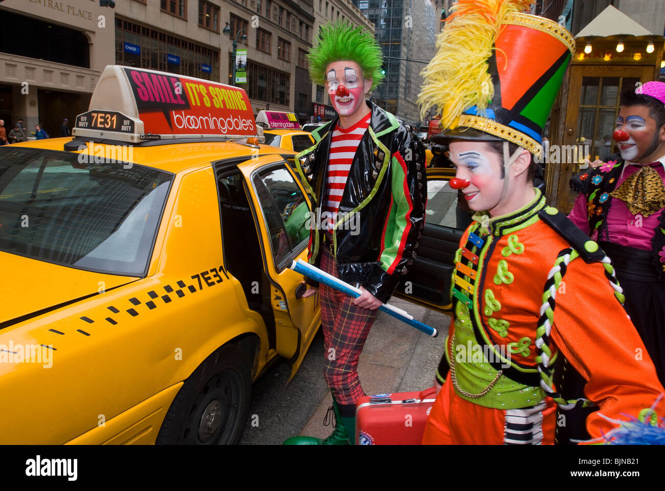 Clowns from the Ringling Bros. Barnum & Bailey Circus leave via taxicab from Grand Central Terminal in New York - Stock Image