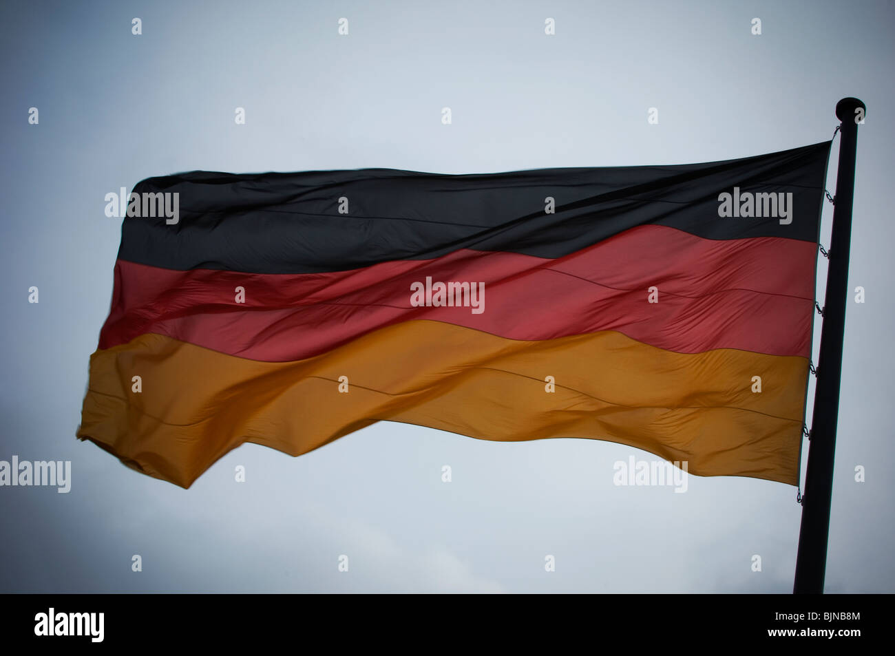 The German flag flying in the air Berlin Germany Europe - Stock Image