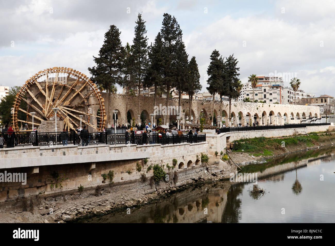 Water wheel or noria in Hama, Syria - Stock Image