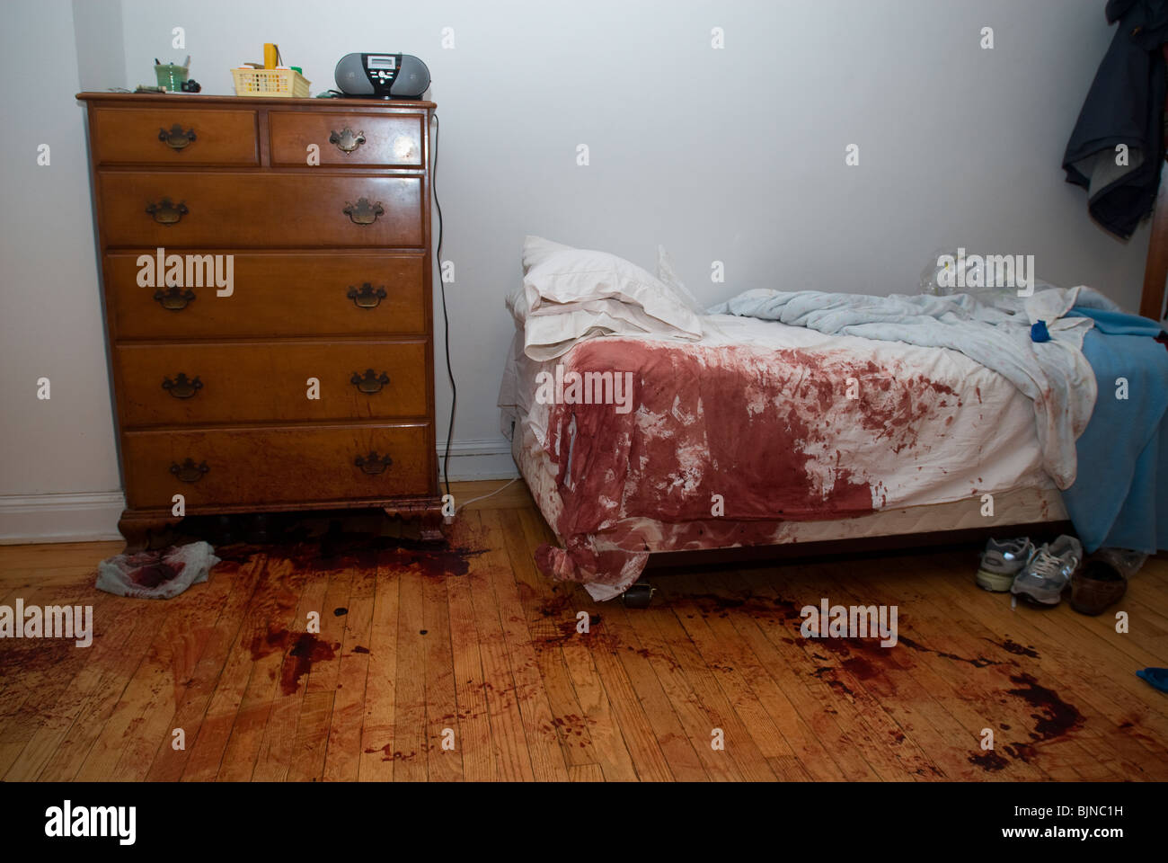blood stained bed and floor are seen in an apartment in new york