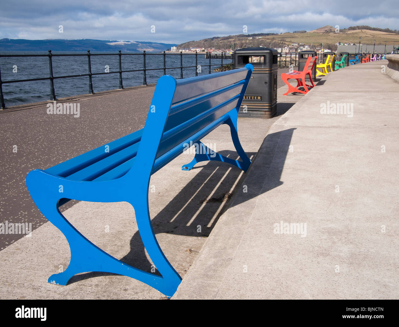 Coloured Park Benches, Largs, Scotland - Stock Image