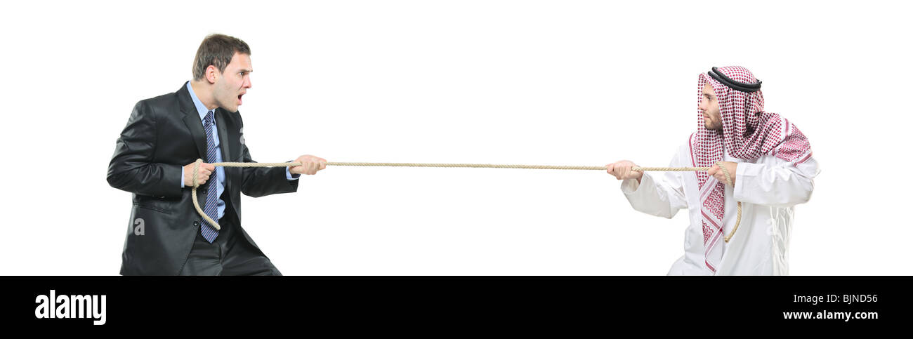 An arab person and a businessman pulling a rope - Stock Image