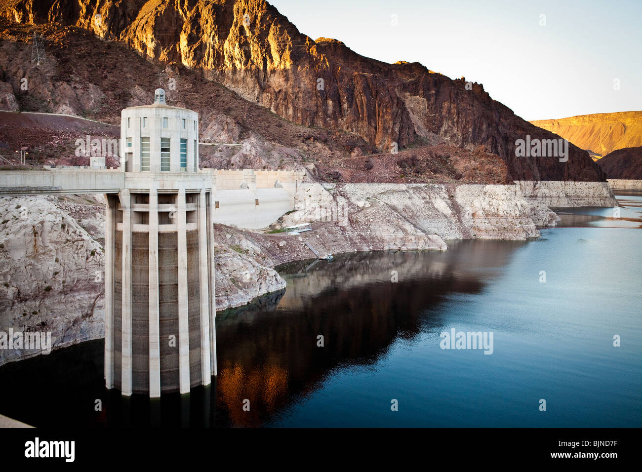 Marks along the canyon walls of Lake Mead at the Hoover Dam show the low water level due to over use of water resources Stock Photo