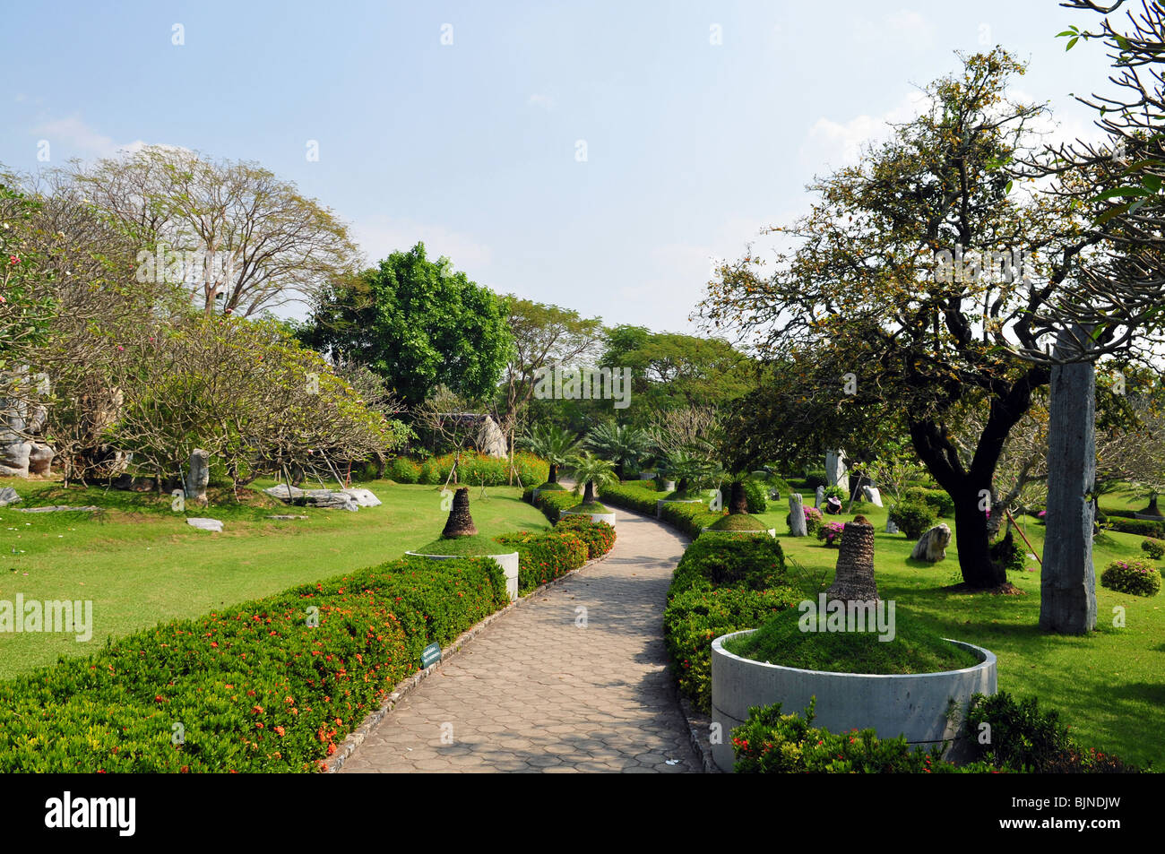 Asian park, paved path in park - Stock Image