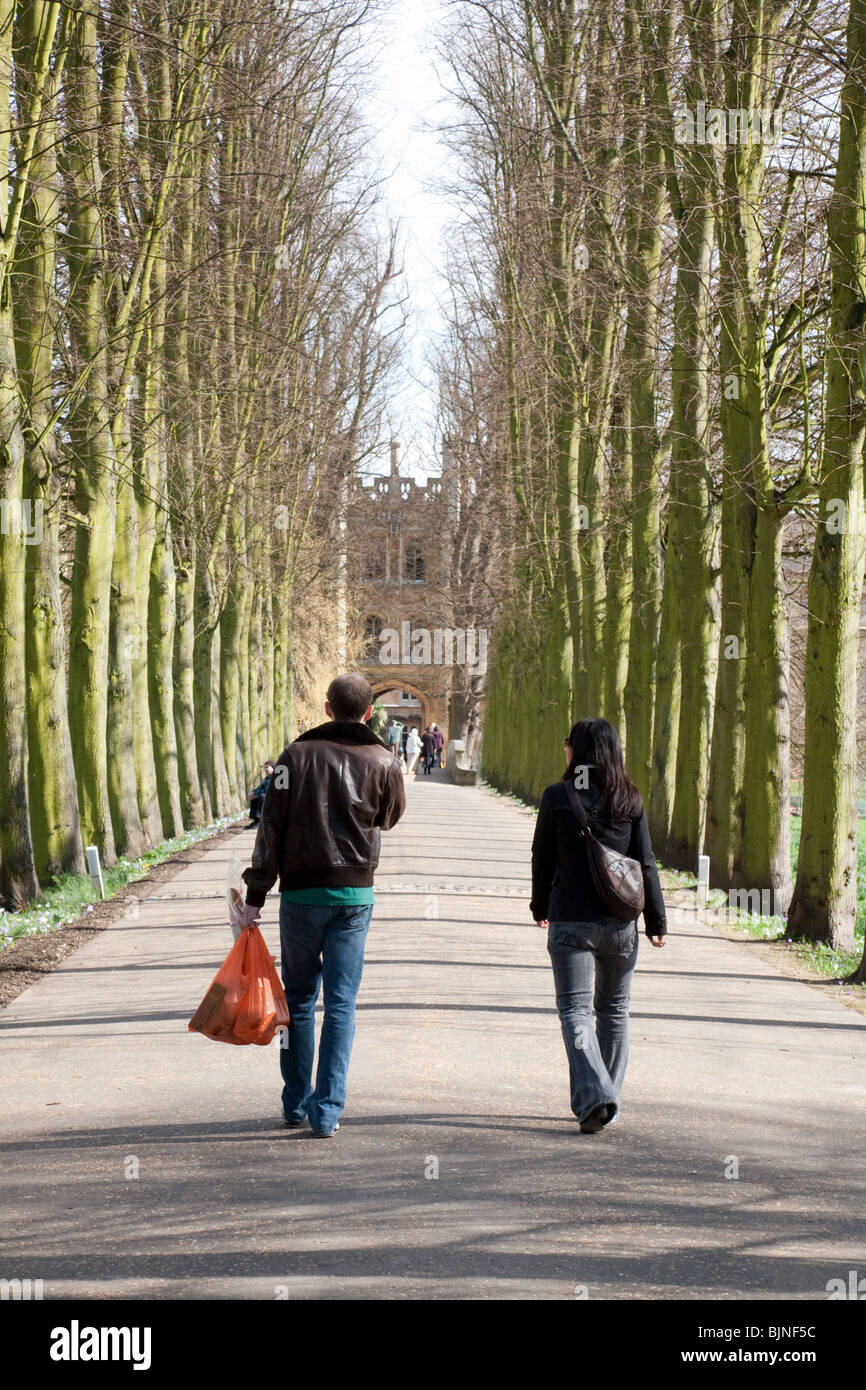 Two university students at Trinity College Cambridge University walking in Trinity college, UK - Stock Image
